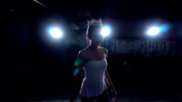 Miss beauty contest warm up ballet dance stretch Asian Fitness Miss Beauty Contest exercise warm up ballet dance in Garage Dark background environment with silver diamond crown, studio lighting rim back light low exposure, steadycam movement princess stock videos & royalty-free footage