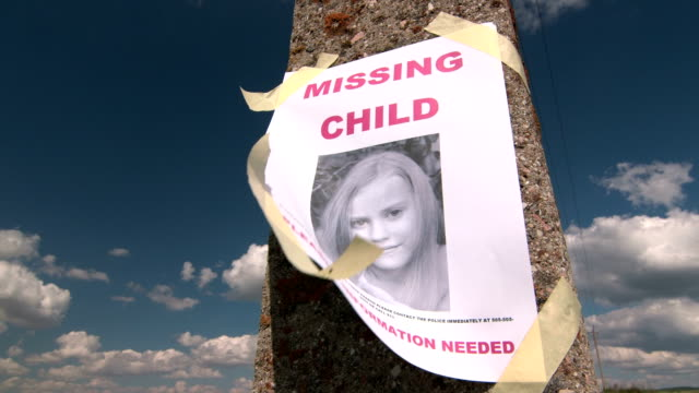 Missing person poster with photo of child Missing person poster with photo of child are posted on pole lost stock videos & royalty-free footage