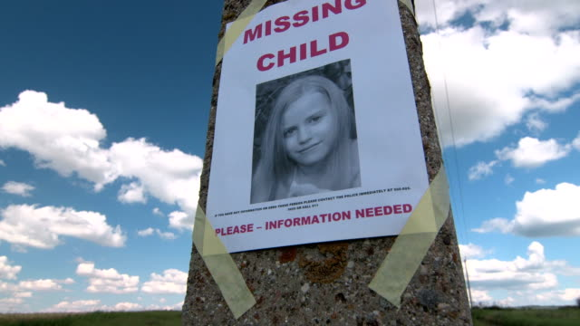 Missing person poster with photo of little girl Missing person poster with photo of little girl are posted on pole tilt up lost stock videos & royalty-free footage