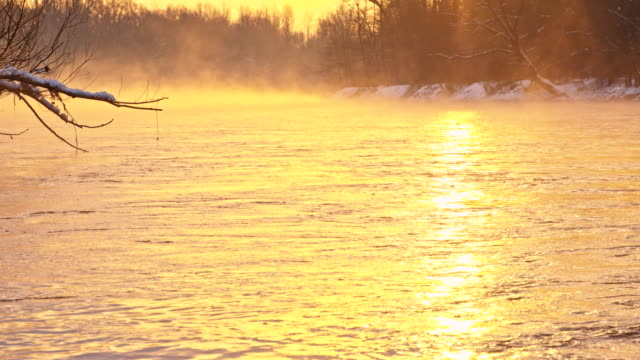 SLO MO Mist Above The River HD1080p: SLOW MOTION shot of a mist above the river in the winter with the surrounding landscape at sunset. The footage was shot in raw. Also available in 4K resolution. light natural phenomenon stock videos & royalty-free footage