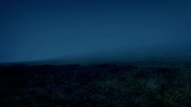 Mist Blowing Over Mountainside At Night video