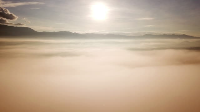 Mist on the Mountain aerial shot with morning sunrise Mist on the Mountain aerial shot with morning sunrise 4K(UHD) natural condition stock videos & royalty-free footage