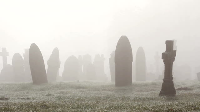 Misty Foggy Spooky Graveyard With Old Tombstones And Grave Headstones