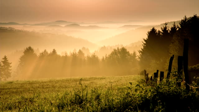 CRANE UP: Misty Morning Dramatic sunrise with misty hills. Eifel mountain range in germany  sunrise dawn stock videos & royalty-free footage