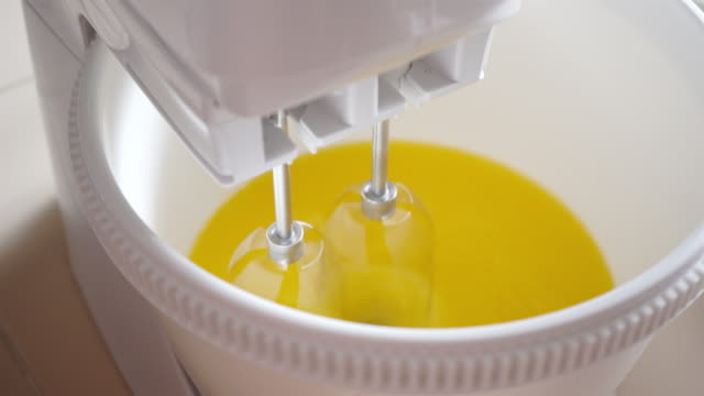 mix cream eggs and butter  machine. video