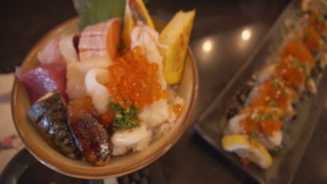 Mix fish sashimi don with rice.japanese food style, healthy food concept Mix fish sashimi don with rice.japanese food style, healthy food concept sashimi stock videos & royalty-free footage