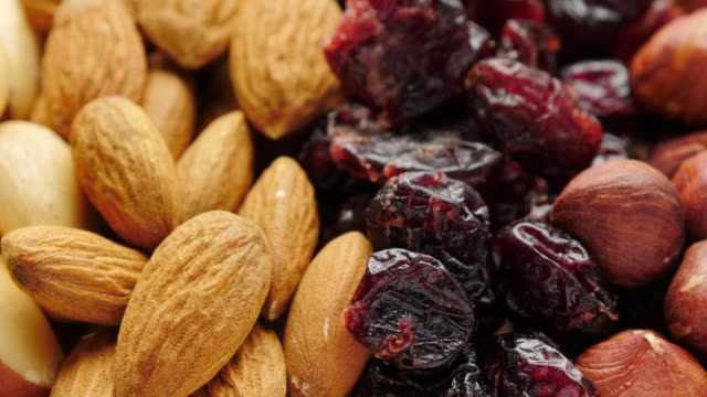 Mix of dried fruits and nuts Close up of assorted dried fruits and nuts. Natural food background dry stock videos & royalty-free footage