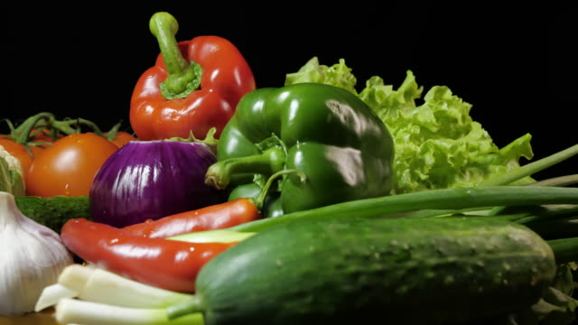 Mix of fresh vegetables on a dark background.