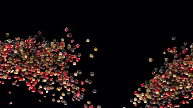 SLO MO LD A mix of peppercorns colliding in the air