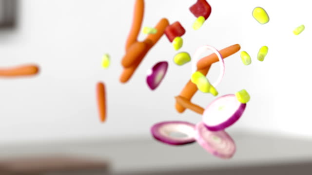 SLO MO Mix Of Vegetables HD1080p: SLOW MOTION CLOSE UP shot of mix of fresh chopped vegetable falling over blurred domestic kitchen background. spice stock videos & royalty-free footage