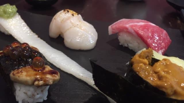 Mix raw sushi - japanese food style food sashimi stock videos & royalty-free footage
