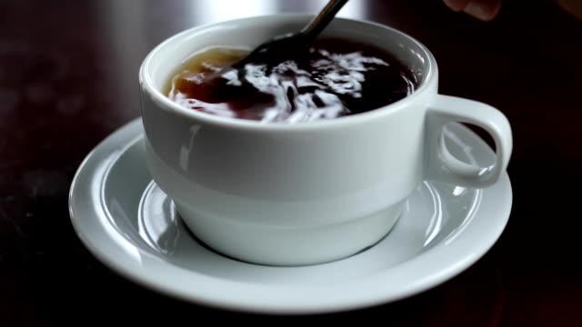 Mix sugar in a tea cup video