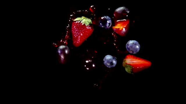 Mixed berries flies to the camera
