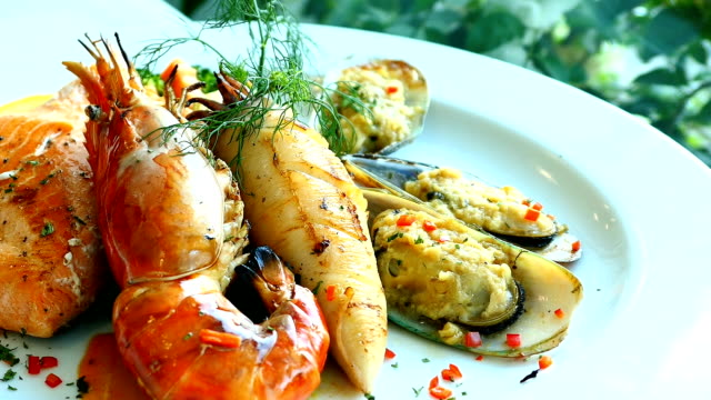 Mixed grilled seafood steak with salmon prawn and other meat video