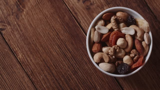 mixed nuts and dried fruits - noci video stock e b–roll