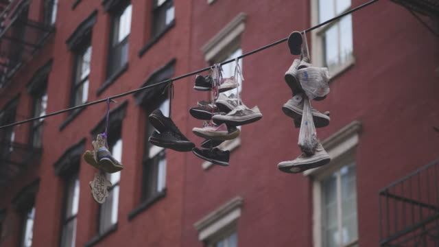 Mixed Old Shoes Hanging on a Wire