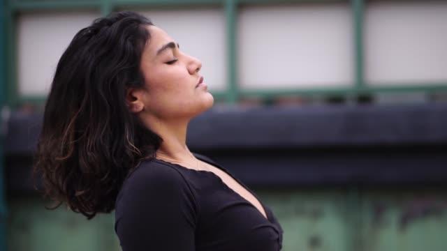 Video Mixed race beautiful fit hispanic black millennial woman dancing.