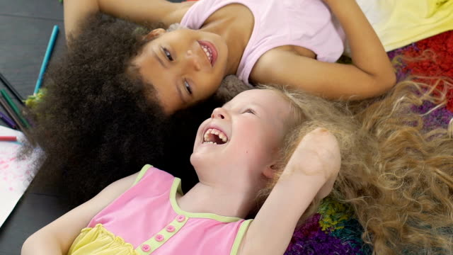 Mixed race best friends smiling and enjoying time together, anti-racism symbol video