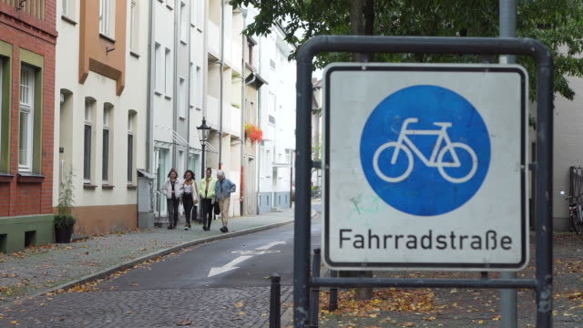 Mixed Race Girlfriends Walking Near Bicycle Lane