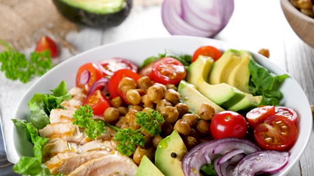 mixed vegetable salad with chicken fillet- buddha bowl - insalata video stock e b–roll