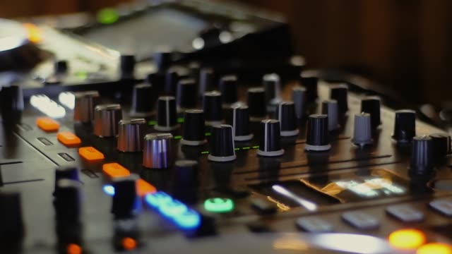 DJ mixer at a nightclub at a party DJ mixer at a nightclub at a party. Many knobs and buttons on the music panel. Camera hitting musical theater stock videos & royalty-free footage