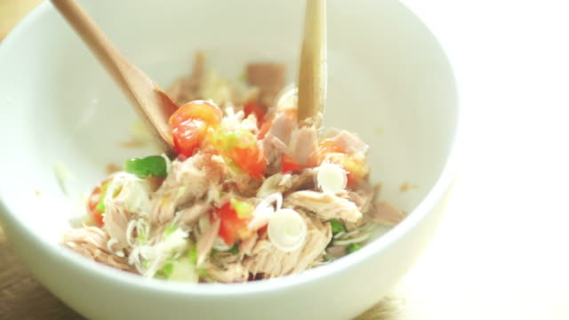 Mixing a Spicy Tuna Salad in the Bowl video