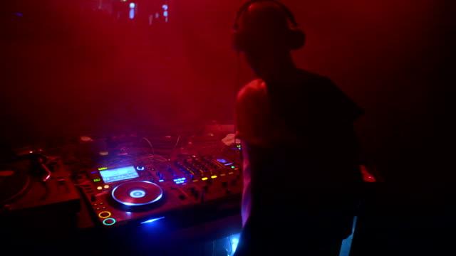DJ mixing music at club video