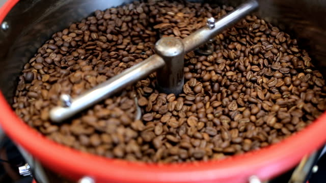 Mixing roasted coffee. Coffee roaster cooling down freshly roasted coffee beans video