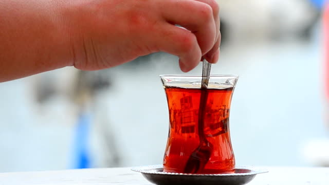 mixing turkish tea - tea cup stock videos & royalty-free footage