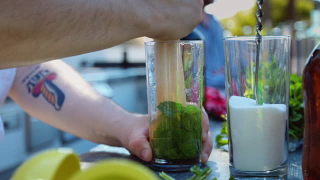 Mixologist Making Drinks at Outdoor Pool Party video