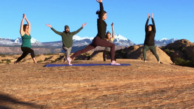 Moab Utah Outdoor Yoga A group of young people in an outdoor yoga class in Moab, Utah USA. western usa stock videos & royalty-free footage