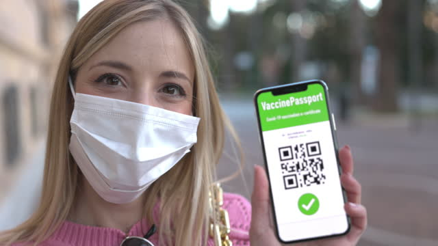 Mobile app screen with a Vaccine Passport video