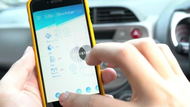 スマートな車とリモート車の制御のためのモバイル アプリケーション - コントロール点の映像素材/bロール