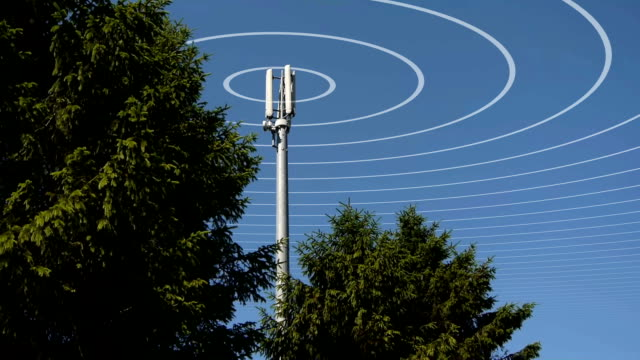 A mobile or cell phone mast transmitting radio waves.