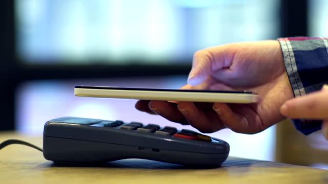 vídeos de stock e filmes b-roll de mobile payment ,online shopping concept - paying with card contactless