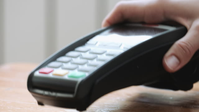 vídeos de stock e filmes b-roll de mobile payment paypass. - paying with card contactless