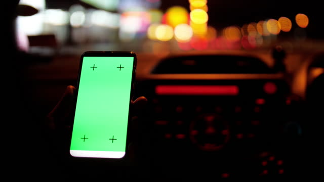 Mobile Phone with green screen at night and Bokeh Circle light