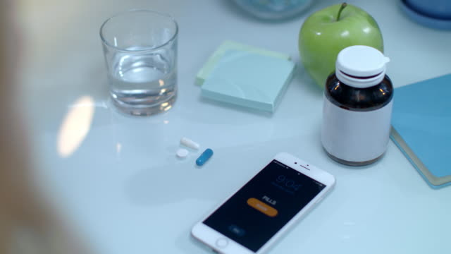 Mobile reminder time to taking medicine. Daily dose of medicaments