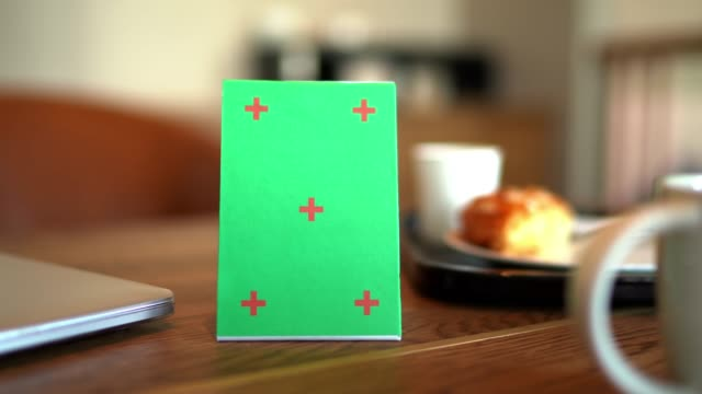 Mock up green signboard tent card menu on wooden table 4K dolly shot with mock up tent card menu, blank green signboard and blurred dessert on table, empty space with red cross mark for insert advertising menu stock videos & royalty-free footage