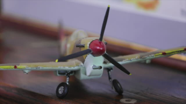 WW2 model airplanes close up pan and focus pull