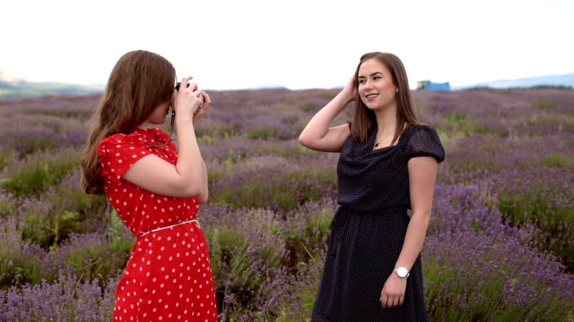 Model and photographer in lavender fields