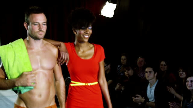 Models on the catwalk at a fashion show in swimwear video