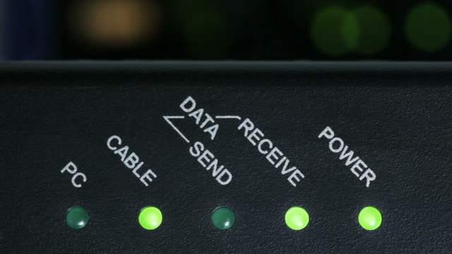 Modem lights flash as data is transferred on network video