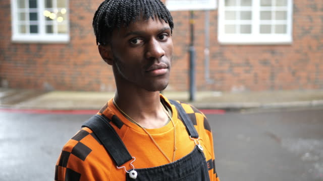 Modern African fashionable man in London with dreadlocks Portrait of Generation Z black male in London, UK. Modern young man in urban surrounding urban fashion stock videos & royalty-free footage