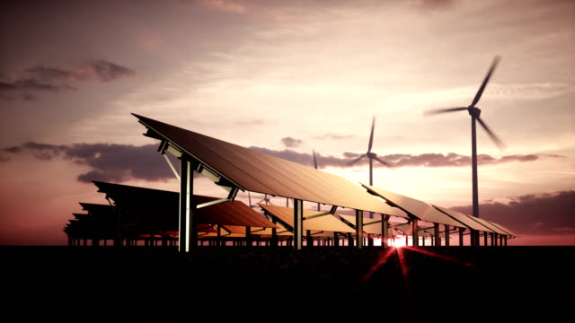 Modern and futuristic aesthetic black solar panels of large photovoltaic power station with wind turbines in background in warm sunset light. 3d rendering video.