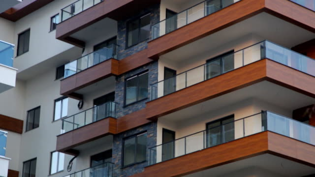 modern apartment establishing shot at sunset - appartamento video stock e b–roll