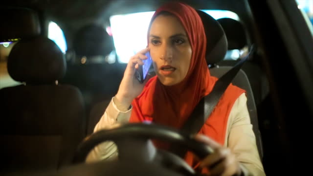 Modern Arab woman using mobile phone in the car video