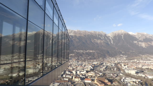 Modern architecture with nature on background. Ski jump. video