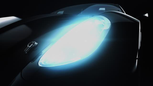 Modern black metallic car in spotlight. video