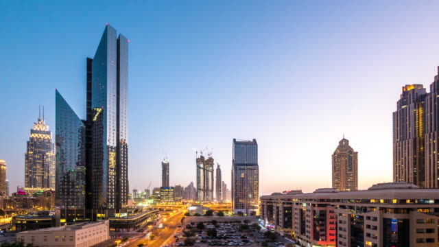 modern buildings in midtown of modern city time lapse - dubai architecture stock videos & royalty-free footage